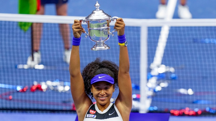 Naomi Osaka, of Japan, holds up the championship trophy after defeating Victoria Azarenka