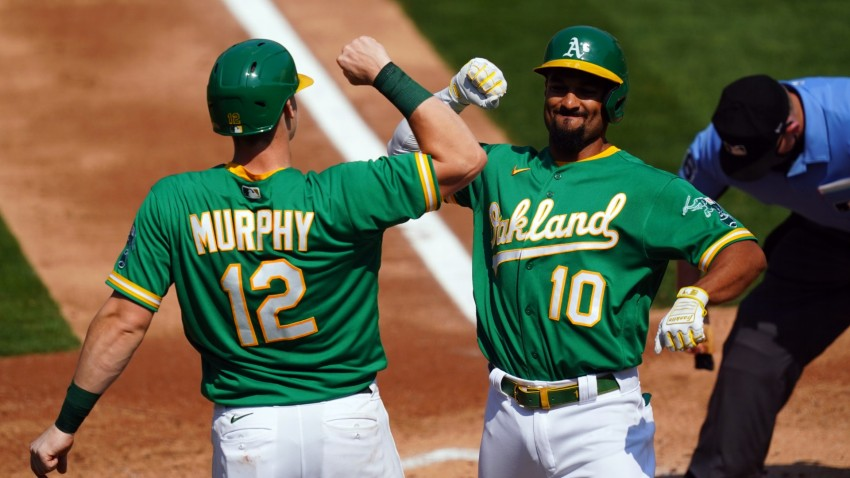 Marcus Semien of the Oakland Athletics is greeted by teammate Sean Murphy.