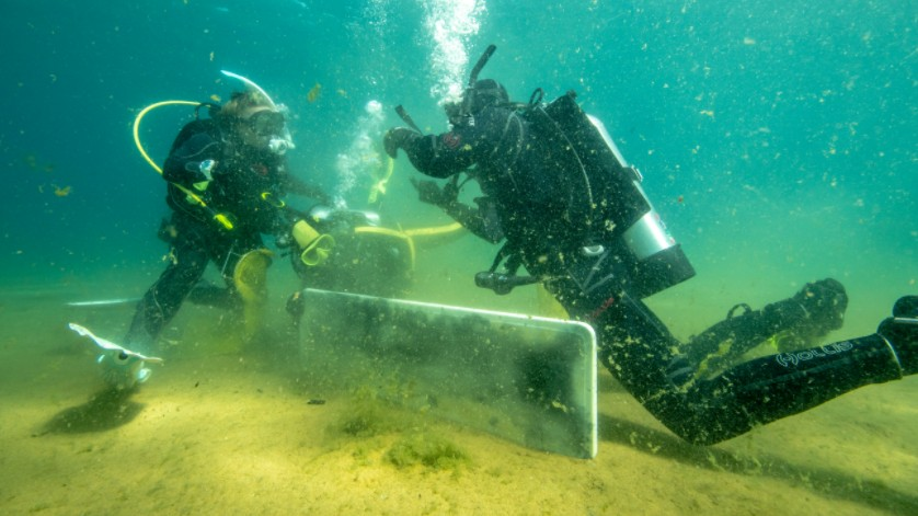Divers recover trash from the bottom of Lake Tahoe.