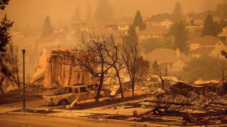 Homes leveled by the Glass Fire line a street in the Skyhawk neighborhood of Santa Rosa, Calif., Sept. 28, 2020.