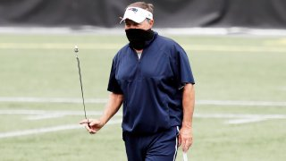 Head coach Bill Belichick of the New England Patriots looks on during training camp at Gillette Stadium on August 28, 2020 in Foxborough, Massachusetts.