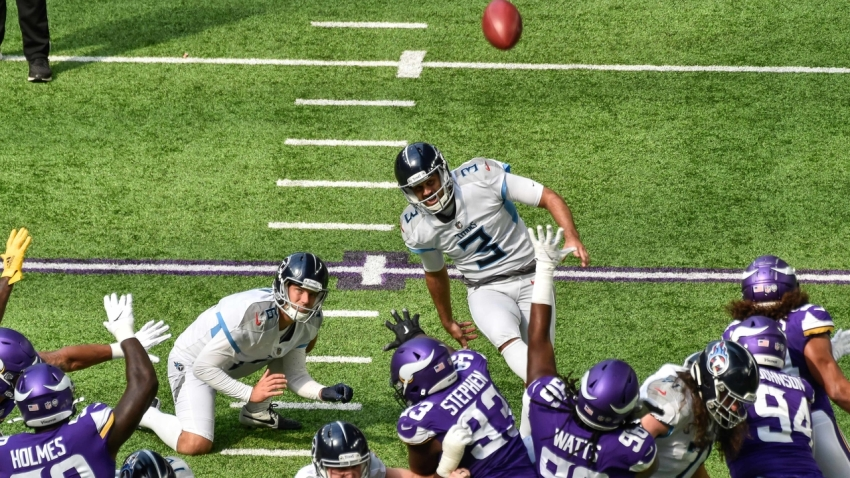 Tennessee Titans kicker Stephen Gostkowski (3) kicks a field goal against the Minnesota Vikings during the first quarter at U.S. Bank Stadium.