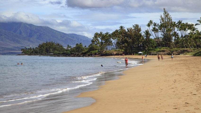 People visit a beach in Kihei, Maui County, Hawaii.