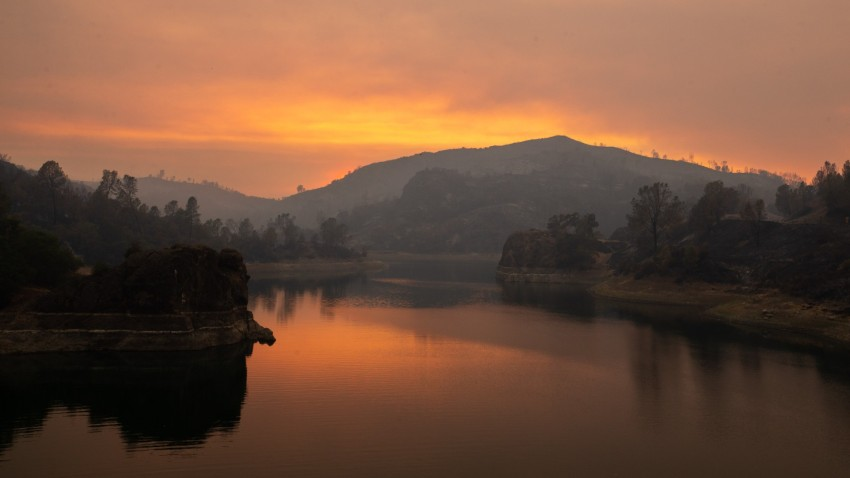 Smoke from the LNU Lightning Complex fire is reflected on Lake Berryessa.