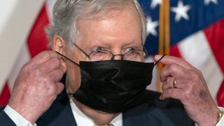 Senate Majority Leader Mitch McConnell of Ky., puts his face mask back on after speaking during a news conference of Senate Republican leadership, Sept. 9, 2020, on Capitol Hill in Washington.