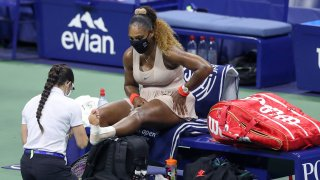 Serena Williams of the United States has her ankle retaped in the third set during her Women's Singles semifinal match against Victoria Azarenka of Belarus on Day Eleven of the 2020 US Open at the USTA Billie Jean King National Tennis Center on September 10, 2020, in the Queens borough of New York City.