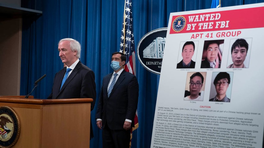 Deputy Attorney General Jeffery Rosen speaks, Sept. 16, 2020, at the Justice Department in Washington. The Justice Department has charged five Chinese citizens with hacks targeting more than 100 companies and institutions in the United States and abroad, including social media and video game companies as well as universities and telecommunications providers.