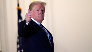 President Donald Trump gestures as he returns to the White House Monday, Oct. 5, 2020, in Washington, after leaving Walter Reed National Military Medical Center, in Bethesda, Md. Trump announced he tested positive for COVID-19 on Oct. 2.