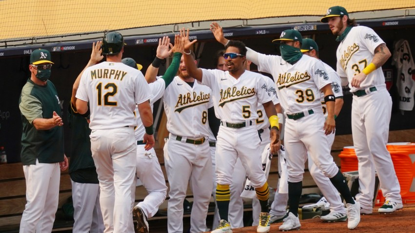 Sean Murphy of the Oakland Athletics returns to the dugout after scoring.