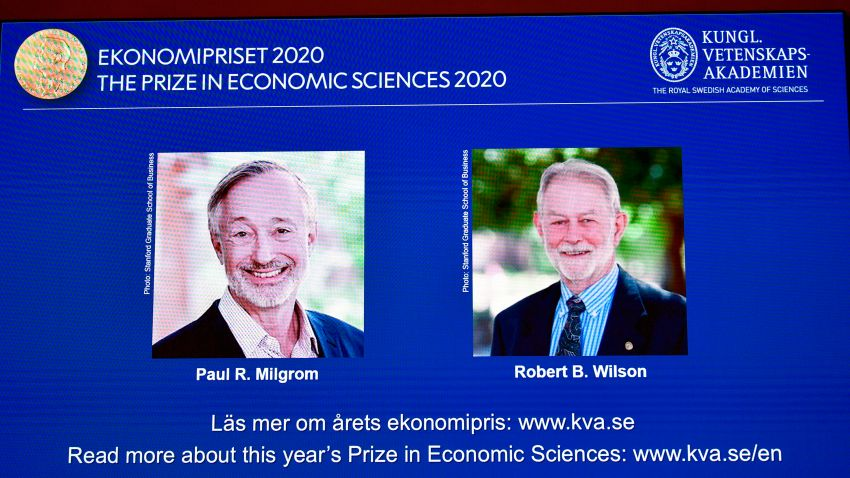 """A screen shows pictures of US economists Paul Milgrom (L) and Robert Wilson during the announcement of the winners of the """"2020 Nobel Prize Sveriges Riksbank Prize in Economic Sciences in Memory of Alfred Nobel"""" at the Royal Swedish Academy of Sciences in Stockholm on October 12, 2020."""