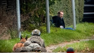 A police marksman and his dog observes convicted killer Peter Madsen threatening police with detonating a bomb while attempting to break out of jail in Albertslund, Denmark on 20 October 2020.