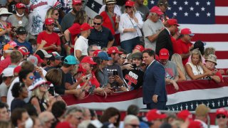 Florida Gov. Ron DeSantis greets people before the arrival of President Donald Trump for his, 'The Great American Comeback Rally', at Cecil Airport on September 24, 2020 in Jacksonville, Florida.
