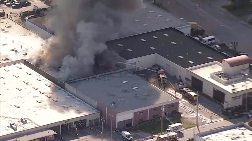 A fire burns at a building in the South San Francisco area.