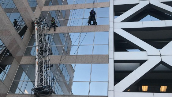 Two window washers left dangling on ropes after their scaffolding collapsed in Walnut Creek.