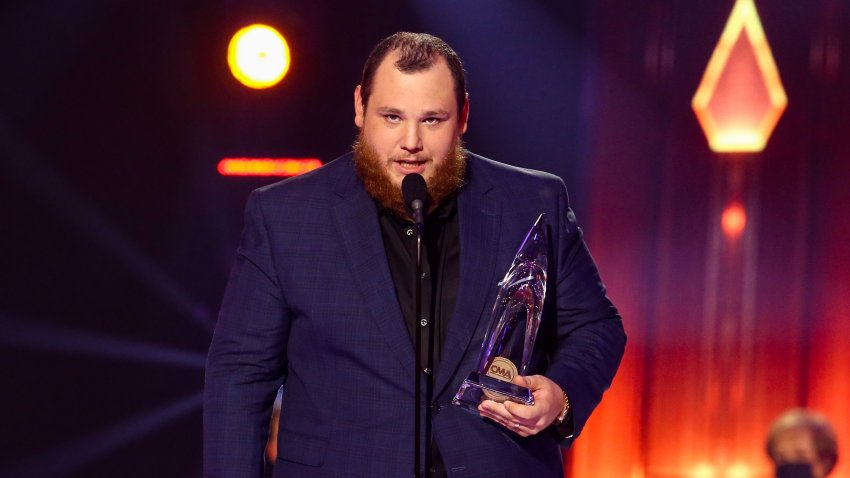 In this Nov. 11, 2020, file photo, Luke Combs accepts an award onstage during the 54th Annual CMA Awards at Nashville's Music City Center in Nashville, Tennessee.