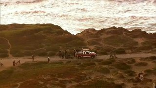 Crews work at the scene of a cliff rescue in San Francisco.