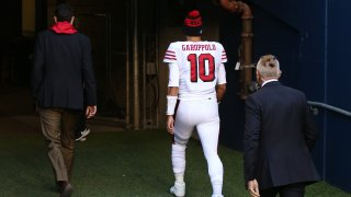 Quarterback Jimmy Garoppolo of the San Francisco 49ers exits the field.