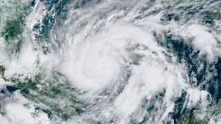 This GeoColor satellite image taken Monday, Nov. 2, 2020, at 1 p.m. EDT, and provided by NOAA, shows Hurricane Eta in the Gulf of Mexico approaching the border of Honduras and Nicaragua. New Hurricane Eta quickly gained force Monday as it headed for Central America on the verge of becoming a major hurricane, threatening massive flooding and landslides across a vulnerable region.