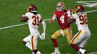 Strong safety Kamren Curl of the Washington Football Team runs for a touchdown on an interception thrown by quarterback Nick Mullens of the San Francisco 49ers.