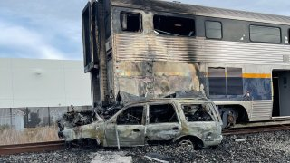 Damage following a train vs. car collision in Newark.