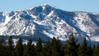 Snow dusts the mountains surrounding South Lake Tahoe.
