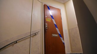 Barrier tape of the police is fixed on the door of an apartment in Haninge, south of Stockholm, on December 1, 2020, one day after a man in his 40s who was kept locked by his mother was found there.