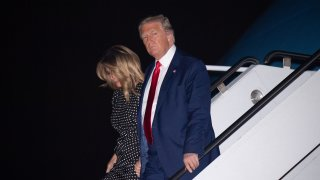 US President Donald Trump and First Lady Melania Trump disembark from Air Force One upon arrival at Palm Beach International Airport in West Palm Beach, Florida, December 23, 2020, as he travels to Mar-a-lago for Christmas and New Year's.