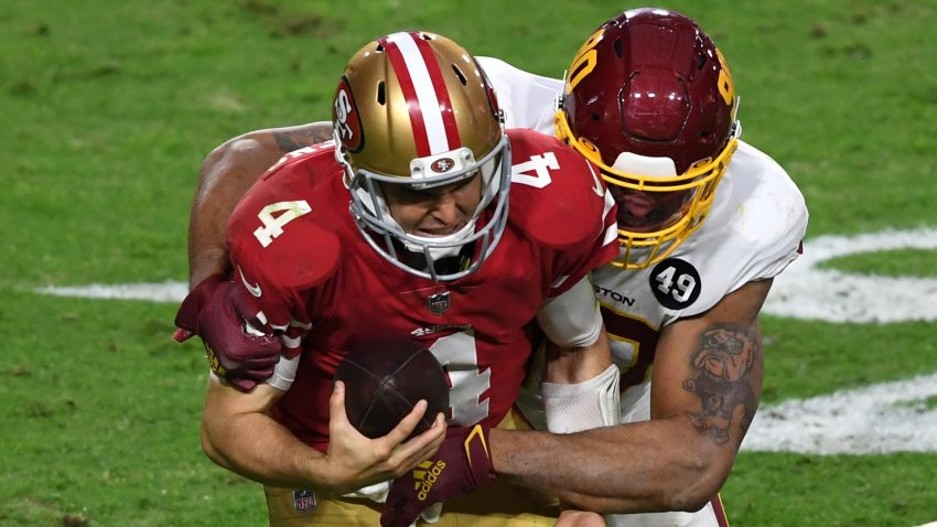 Quarterback Nick Mullens of the San Francisco 49ers is sacked.