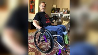In this May 15, 2018 photo, Samuel Kolb poses for a photo in San Mateo, Calif. A Northern California county has agreed to pay nearly $10 million to settle a lawsuit by Kolb, who was going through a severe epileptic episode when a deputy shot him in the abdomen, paralyzing him from the waist down.