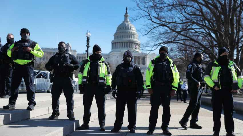 Members of the Metropolitan Police Department of the District of Columbia are seen in front of the U.S. Capitol a day after a pro-Trump mob broke into the building on Jan. 7, 2021, in Washington, DC.