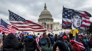 In this Jan. 6, 2021, file photo, former President Donald Trump's supporters gather outside the Capitol building.