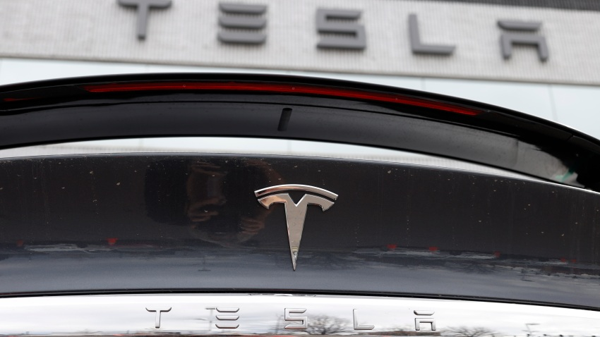A 2020 Model X sits in front of a Tesla dealership in Littleton, Colorado, April 26, 2020. An investigation from the National Transportation Safety Board, sparked by crashes that all involved Tesla vehicles, says there are too little guidelines for first responders dealing with fires caused by high-voltage lithium-ion batteries used by electric cars.