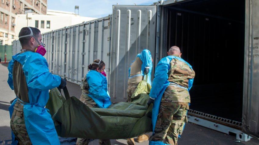 National Guard members assisting with processing COVID-19 deaths, placing them into temporary storage at the medical examiner-coroner's office in Los Angeles