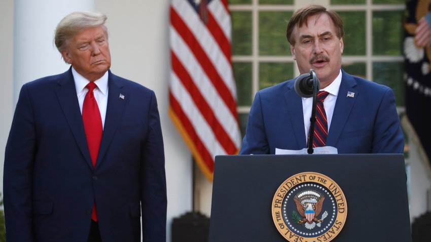 In this March 30, 2020, file photo, My Pillow CEO Mike Lindell speaks as President Donald Trump listens during a briefing about the coronavirus in the Rose Garden of the White House, in Washington, D.C.