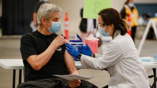 A person receives the COVID-19 vaccine.