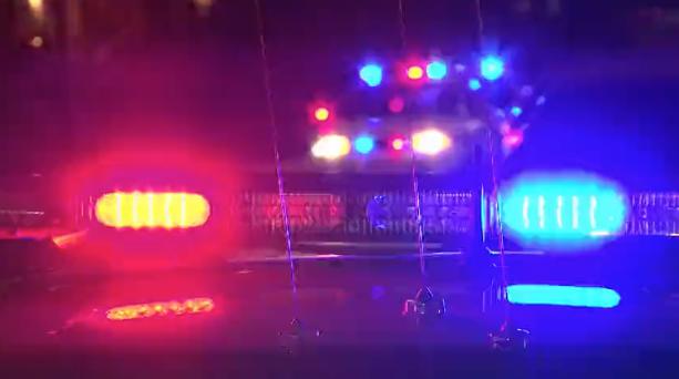 Police lights against a dark sky
