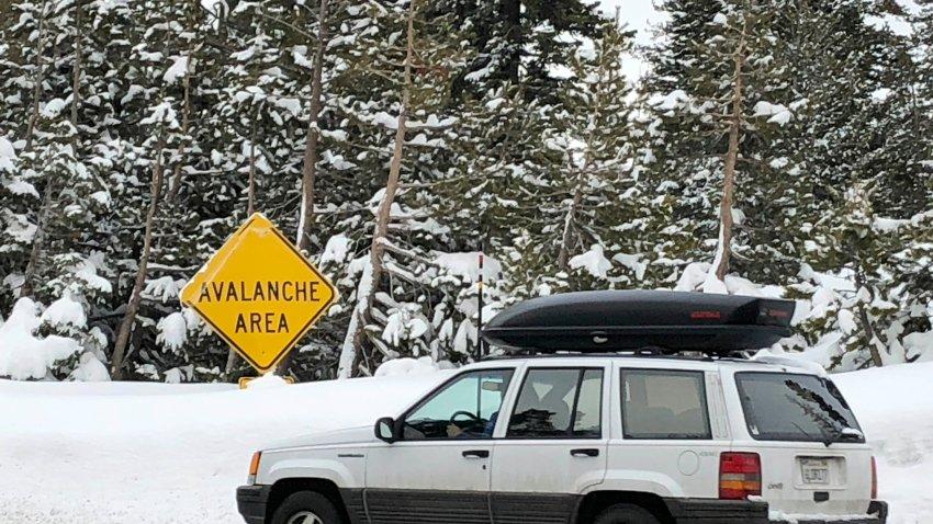 Skiers leave the parking lot at Alpine Meadows ski resort in Alpine Meadows, California, Friday, Jan. 17, 2020.