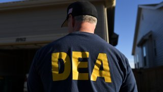 In this Jan. 31, 2019, file photo, a DEA agent is seen in Commerce City, Colorado.