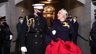 In this Jan. 20, 2021, file photo, Lady Gaga is escorted by U.S. Marine escort Capt. Evan Campbell to sing the National Anthem at the inauguration of U.S. President-elect Joe Biden on the West Front of the U.S. Capitol in Washington, D.C.