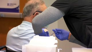 A COVID-19 vaccination is administered in Contra Costa County.