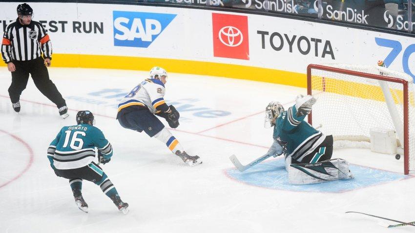 St. Louis Blues Right Wing Mackenzie MacEachern scores past San Jose Sharks Goalie Devan Dubnyk.