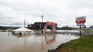 Water floods the vendor area as races for both the Truck Series and NASCAR Cup Series auto race were postponed due to inclement weather at Bristol Motor Speedway, Sunday, March 28, 2021, in Bristol, Tennessee.