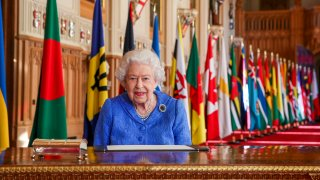 In this March 5, 2021, file photo, Britain's Queen Elizabeth II poses for a photo while signing her annual Commonwealth Day Message inside St George's Hall at Windsor Castle, England.