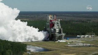 In this image from video made available by NASA, the core stage of the Space Launch System, NASA's planned moon rocket, is tested at the Stennis Space Center near Bay St. Louis, Miss., on Thursday, Mar. 18, 2021. With this critical test finally finished, NASA now will send the rocket segment to Kennedy Space Center for launch preparations.