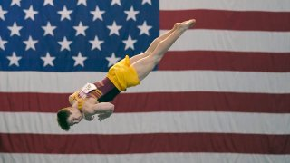 Michael Moran, representing the University of Minnesota, competes during the Winter Cup gymnastics event