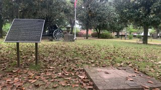 A brick base sits empty Tuesday, April 13, 2021, where chair carved out of limestone honoring Confederate President Jefferson Davis was stolen from Confederate Memorial Circle, a private section of Live Oak Cemetery in Selma, Ala. Police recovered the chair in New Orleans.