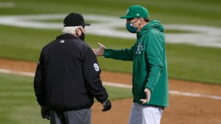 Oakland Athletics manager Bob Malvin talks to umpire Brian Gorman.