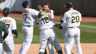 Mitch Moreland of the Oakland Athletics and teammates celebrate.