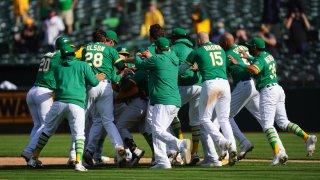 Ramon Laureano of the Oakland Athletics celebrates with his teammates.