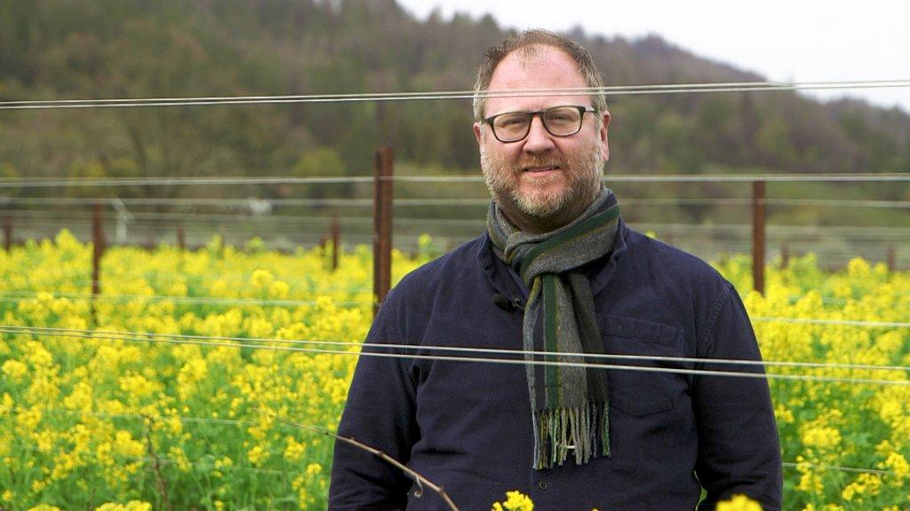 Vintner Dan Petrosky of Larkmead Winery stands in a research plot.